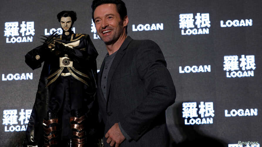 Actor Hugh Jackman poses with a cloth puppet, a traditional type of opera during a news conference during the Asian premiere of the X-Men series film 'Logan' in Taipei, Taiwan, Feb. 28, 2017.