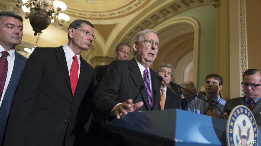 FILE - Senate Republican Majority Leader Mitch McConnell, center, joined by Republican colleagues, holds a news conference on Capitol Hill, in Washington, Aug. 1, 2017.