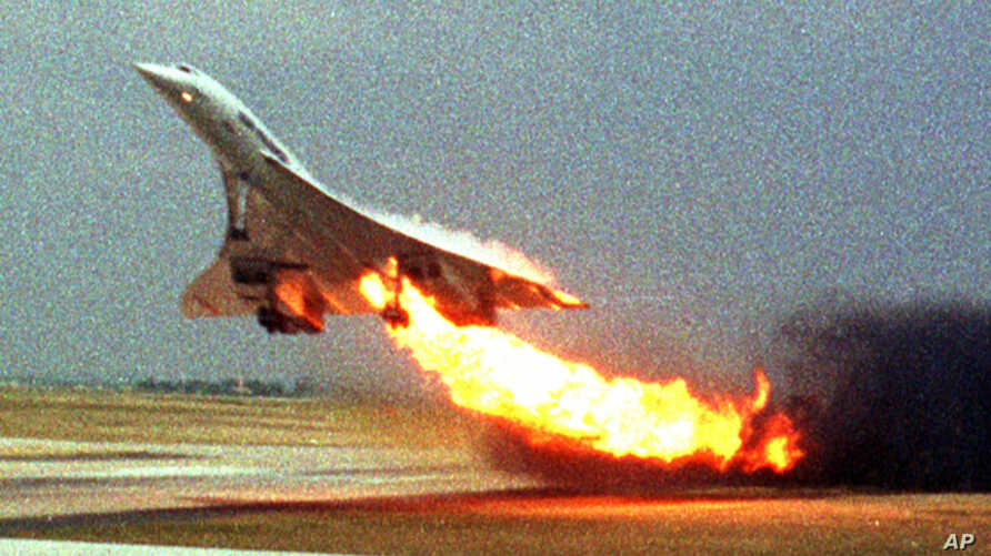 Air France Concorde on fire after striking debris on the Paris airport runway in 2000.
