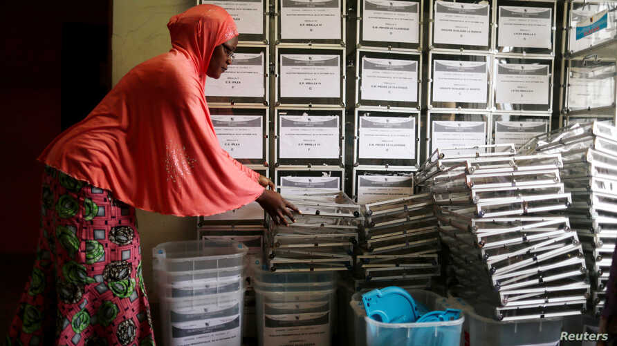An administration municipal worker prepares ballot boxes before distributing them to the polling station for Sunday's presidential election in Yaounde, Cameroon Oct. 5, 2018.