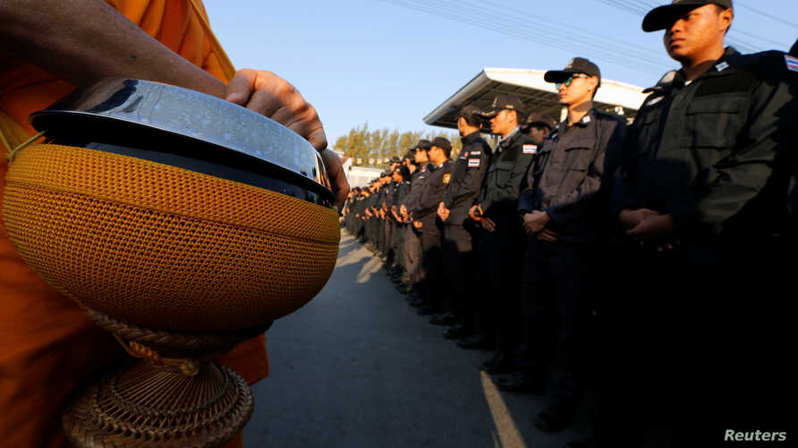 Thai police block Buddhist monks at the gate of Dhammakaya Temple in Pathum Thani province, Thailand, Feb. 16, 2017.