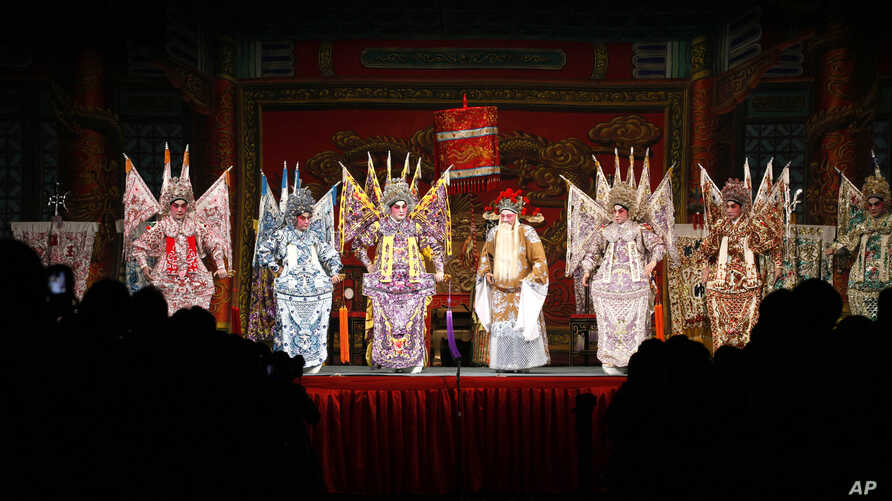Cantonese opera actors perform inside a bamboo theater in Kowloon District, Hong Kong Friday, Jan. 20, 2012.