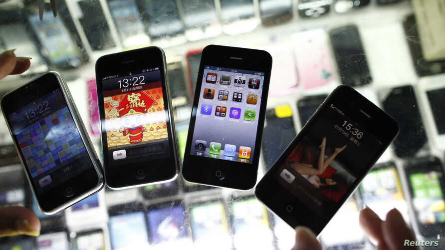 FILE - Fake iPhones are displayed at a mobile phone stall in Shanghai, China, Aug.11, 2011.