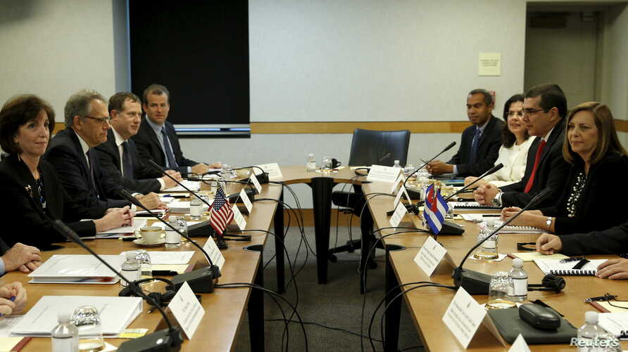 Assistant Secretary of State for Western Hemisphere Affairs Roberta Jacobson (L) and Josefina Vidal (R), director general of the U.S. division of the Cuban Foreign Ministry, during a meeting at  meeting at the State Department in Washington, May 21,