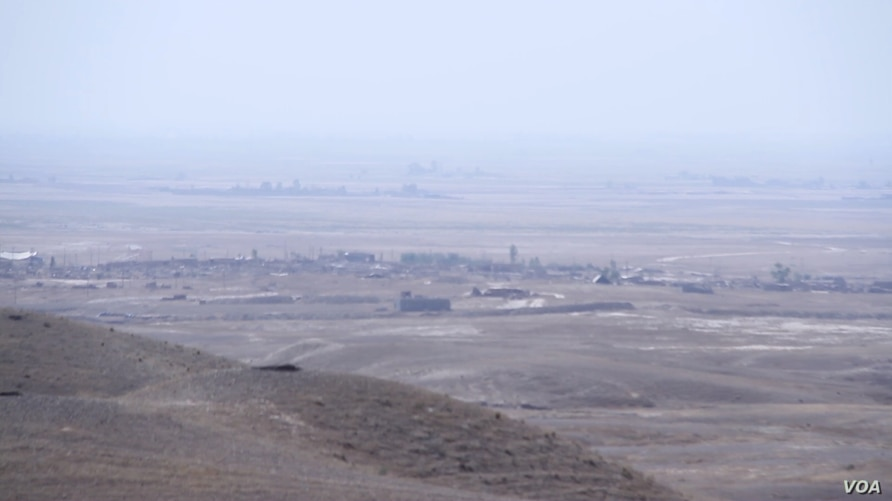 A view of the IS-held Iraqi town of Hawija as seen from a nearby Kurdish frontline on Oct. 12, 2016. (image courtesy of Dilshad Anwar)