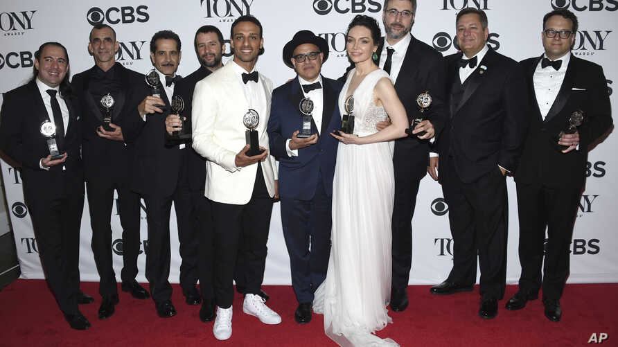 """Cast and crew of """"The Band's Visit"""" pose in the press room with the award for best musical at the 72nd annual Tony Awards at Radio City Music Hall on Sunday, June 10, 2018, in New York."""
