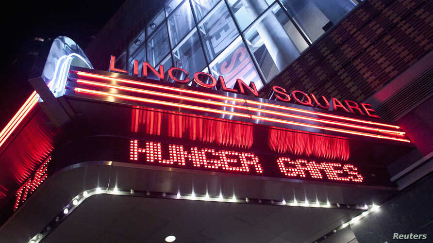 "FILE - A marquee advertising ""The Hunger Games""  is seen at the AMC Loews Lincoln Square Theatre in New York, March 22, 2012."