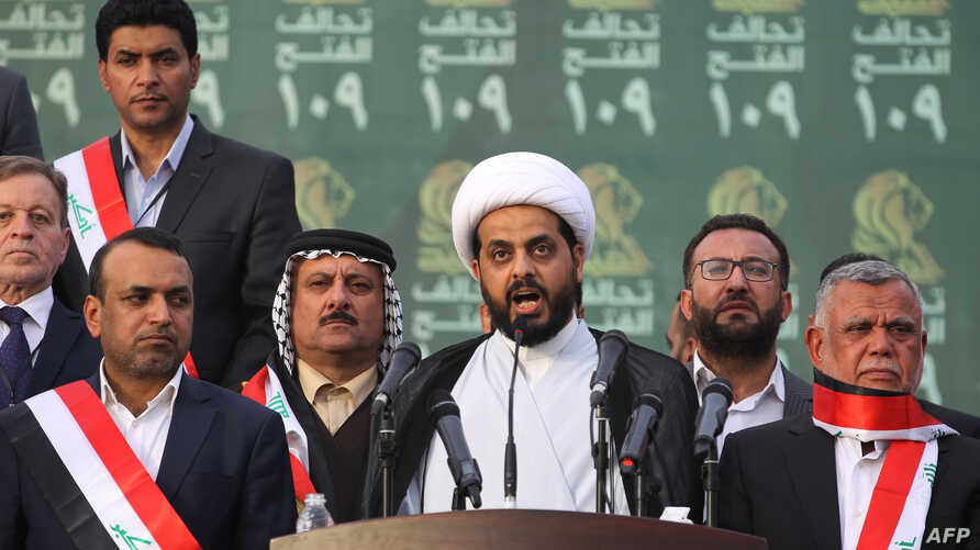 FILE - Qais al-Khazali (C) leader of the Asa'ib Ahl al-Haq, one of the units of the Hashed al-Shaabi (Popular Mobilisation units) gives a speech during a campaign rally for the Fateh Alliance, a coalition of Iranian-supported militia groups, in Baghd