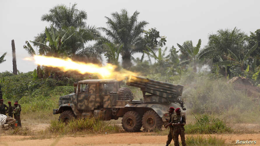 FILE - Democratic Republic of Congo soldiers are seen launching missiles during their military operation against ADF rebels outside the town of Beni, in North Kivu province, Jan. 18, 2014.