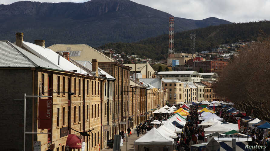 Shoppers explore the historic Salamanca Markets in Australia where a huge range of food, clothes and local crafts are on offer, August 27, 2011