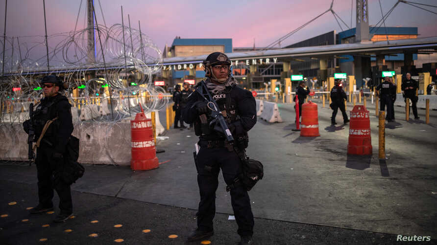 U.S. Customs and Border Protection Special Response Team officers stand guard at the San Ysidro Port of Entry after the land border crossing was temporarily closed to traffic from Tijuana, Mexico, Nov. 19, 2018.
