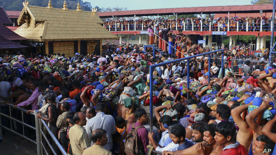 FILE - Hindu worshippers stand in long queues outside the Sabarimala temple in the southern Indian state of Kerala, Dec. 1, 2015.