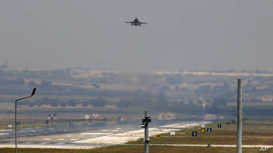A Turkish Air Force jet is seen taking off from Incirlik Air Base, near Adana, southeastern Turkey, July 28, 2015.