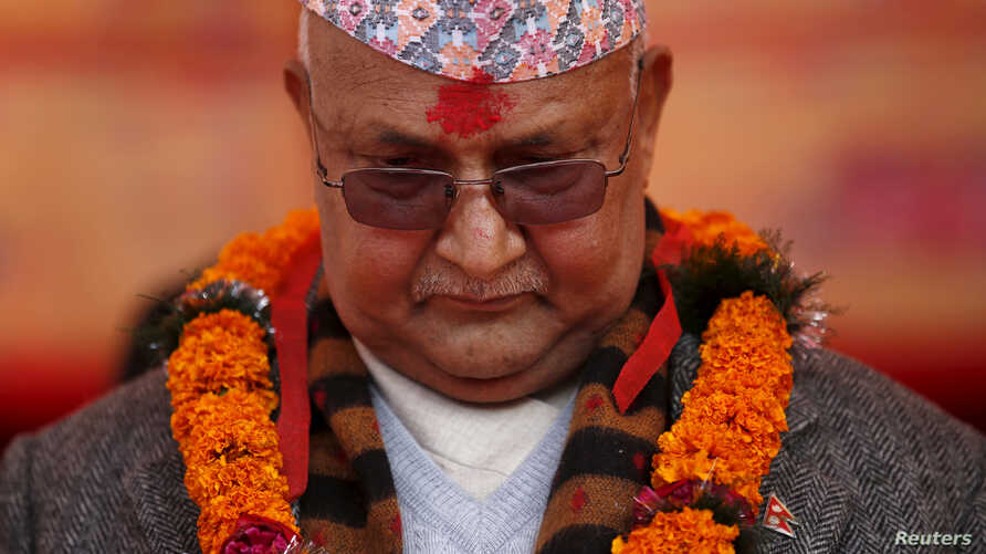 FILE- Then-Prime Minister of Nepal Khadga Prasad Sharma Oli, also known as K.P. Oli, observes a minute of silence for earthquake victims during an event organised to mark the 18th National Earthquake Safety Day in Bungamati village, Nepal, Jan. 16, 2