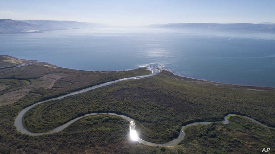 FILE - An aerial view shows the Jordan River estuary of the Sea of Galilee near the community settlement of Karkom, northern Israel, Dec. 8, 2017. Israel is heading into its fifth consecutive year of drought.