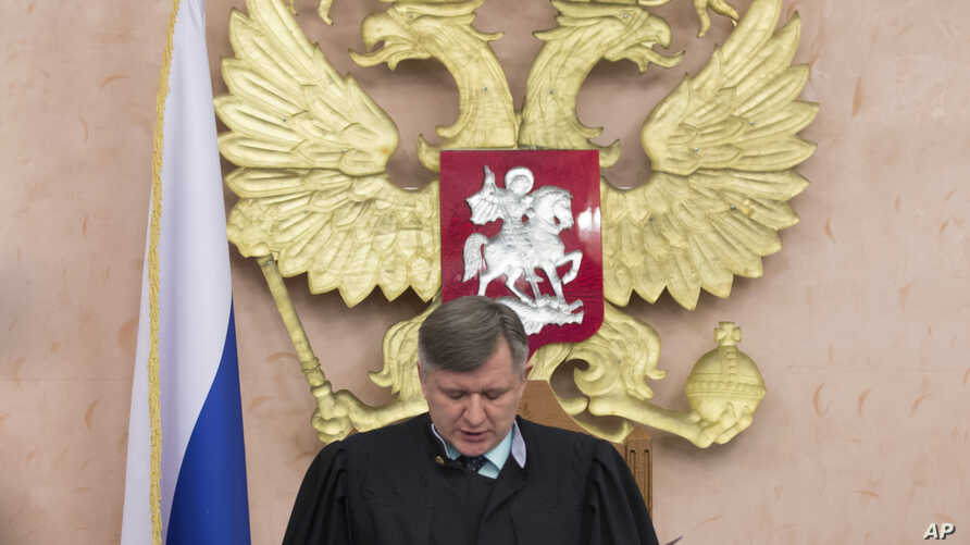 Russia's Supreme Court judge Yuri Ivanenko reads the decision in a court room in Moscow, Russia, April 20, 2017.  Russia's Supreme Court banned the Jehovah's Witnesses from operating in the country.
