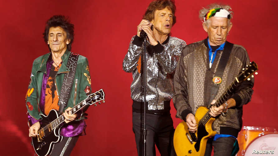 FILE - Ron Wood, Mick Jagger (C) and Keith Richards of the Rolling Stones performs during the band's first concert of the 'No Filter' European tour, at the Stadtpark in Hamburg, Germany, Sept. 9, 2017.