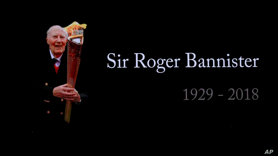 A video screen shows a tribute to Roger Bannister at the World Athletics Indoor Championships in Birmingham, Britain, Sunday, March 4, 2018. Bannister, the first person to run a mile in under four minutes, died March 3.