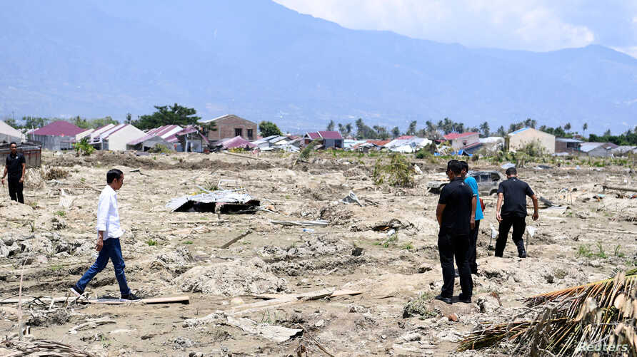 Indonesian President Joko Widodo visits an area affected by an earthquake at Petobo district, Palu, Central Sulawesi, Indonesia, Oct. 3, 2018, in this photo taken by Antara Foto.
