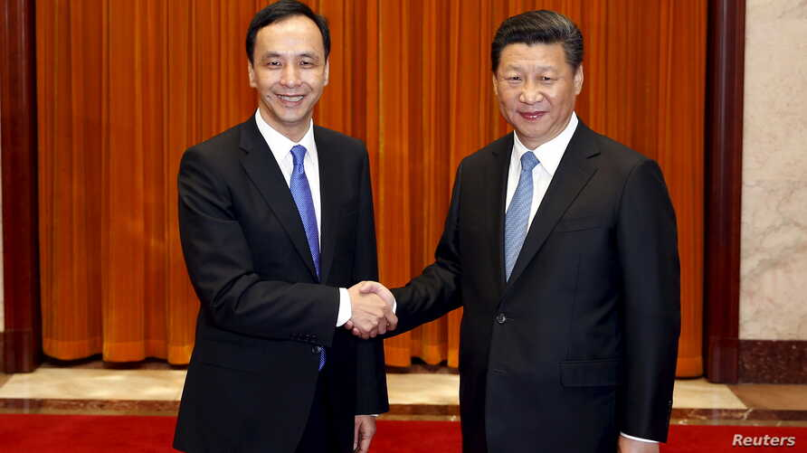 Chairman of Taiwan's ruling Nationalist Kuomintang Party (KMT) Eric Chu, also New Taipei mayor, shakes hands with China's President Xi Jinping as they pose for pictures during their meeting in Beijing, China, May 4, 2015.