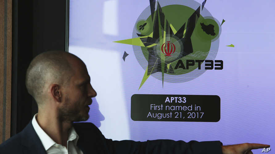 Alister Shepherd, the director of a subsidiary of the cybersecurity firm FireEye, gestures during a presentation about the APT33 hacking group, which his firm suspects are Iranian government-aligned hackers, in Dubai, United Arab Emirates, Sept. 18,