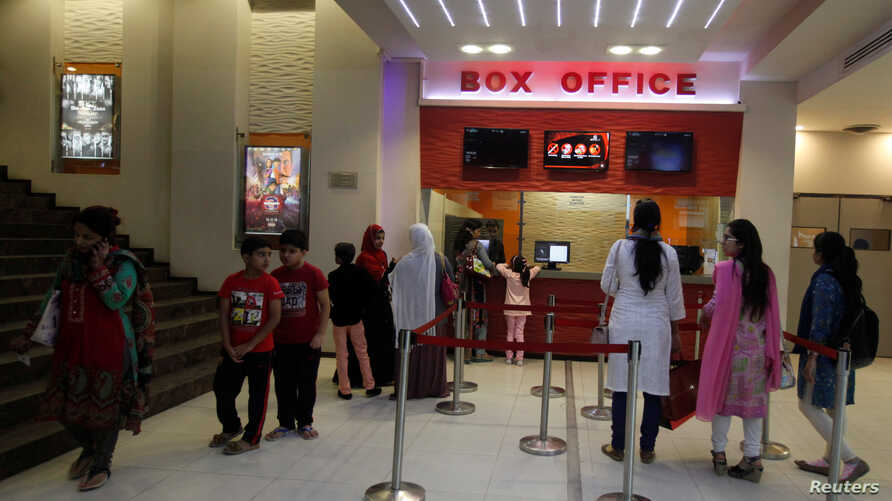 People stand outside a ticket counter at the Atrium Cinema in Karachi, Pakistan, Dec. 19, 2016.