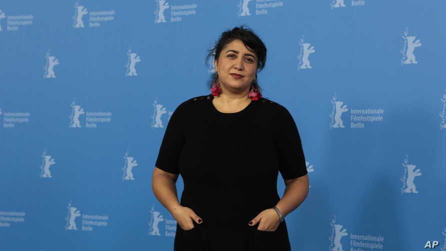 """FILE - Director of """"Joy"""" Sudabeh Mortezai poses for photographers at a photo call at the International Film Festival Berlinale in Berlin, Germany, Feb. 14, 2014."""
