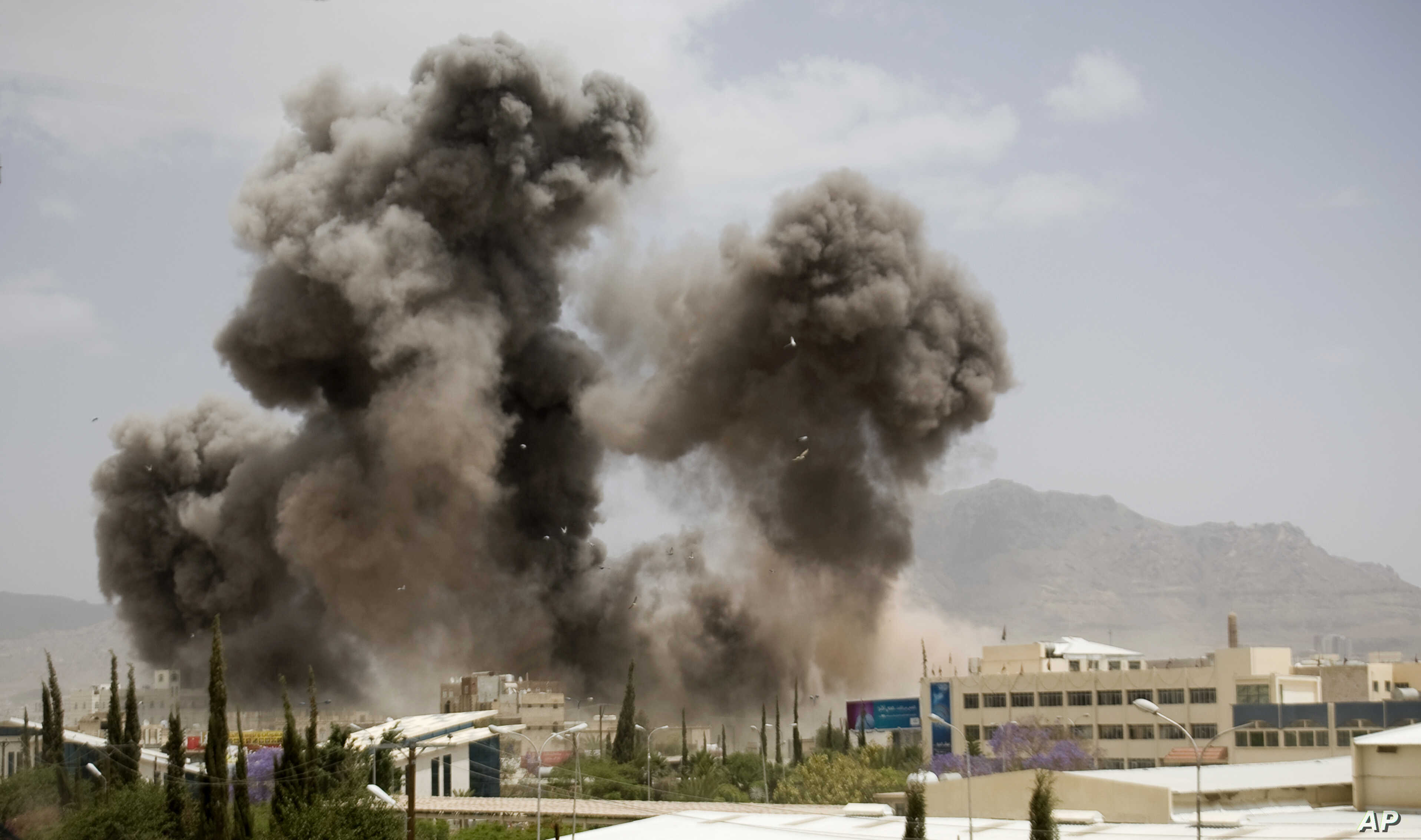 Smoke billows from a Saudi-led airstrike on Sanaa, Yemen, Wednesday, April 8, 2015. A state-run broadcaster in Iran is reporting that the Islamic Republic has sent a navy destroyer and another vessel to waters near Yemen amid a Saudi-led airstrike ca
