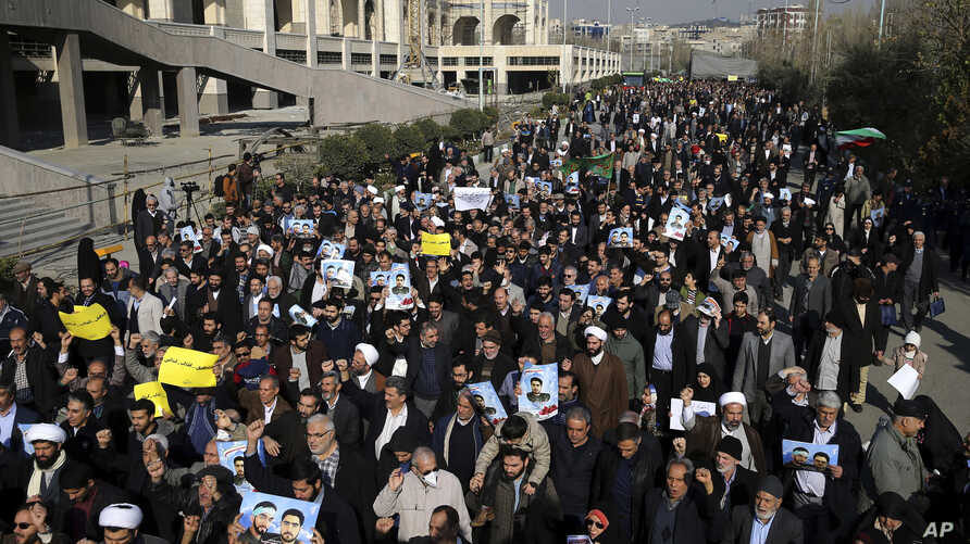Iranian worshipers chant slogans during a rally against anti-government protesters after Friday prayers in Tehran, Iran, Jan. 5, 2018.