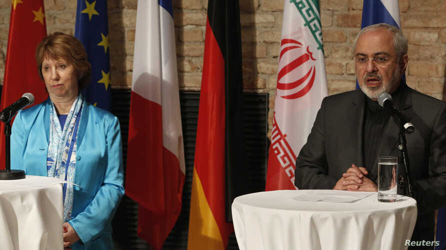EU foreign policy chief Catherine Ashton (L) and Iranian Foreign Minister Mohammad Javad Zarif attend a news conference in Vienna, July 18, 2014.