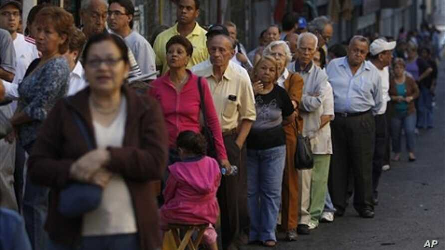 People line up outside a polling station during congressional elections in Caracas, Venezuela, Sunday, Sept. 26, 2010.