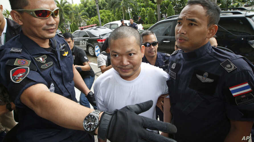 Fugitive ex-monk Wirapol Sukphol is escorted by the Department of Special Investigation officials to the prosecutor's office in Bangkok, Thailand, July 20, 2017.