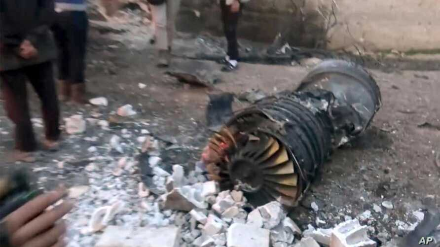 A photo provided by the Ibaa News Agency, the media arm of al-Qaida's branch in Syria, reportedly shows part of a Russian jet that was shot down by rebel fighters over Idlib province in Syria, Feb. 3, 2018.