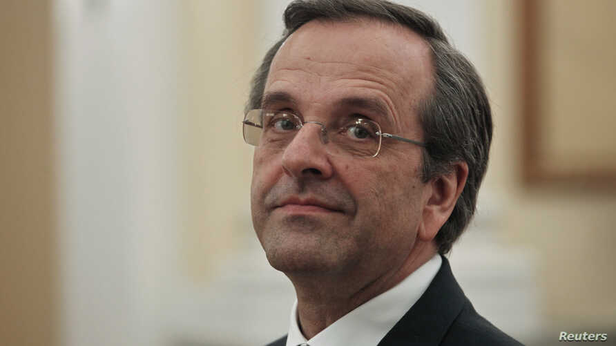 Newly appointed Greek Prime Minister Antonis Samaras smiles before a swearing in ceremony at the presidential palace in Athens, June 20, 2012.