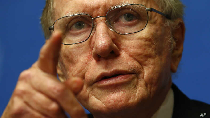 Michael Kirby, Chairperson of the Commission of Inquiry on Human Rights in North Korea, gestures during a news conference after delivering his report to the U.N. Human Rights Council at the United Nations European headquarters in Geneva, Sept. 17, 20