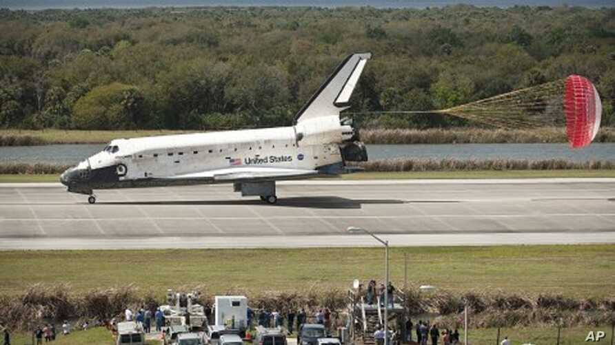 Space Shuttle Discovery (STS-133) lands at Kennedy Space Center in Cape Canaveral, Florida, completing its 39th and final flight, March 9, 2011