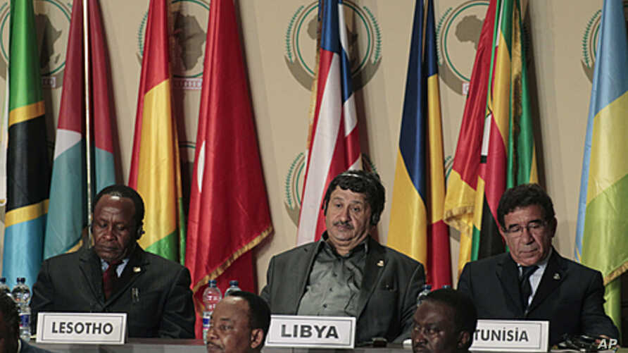 Libyan Foreign Minister Abdelati Obeidi, center, during the opening session of the 17th African Union Summit, at the Sipopo Conference Center outside Malabo, Equatorial Guinea, June 30, 2011