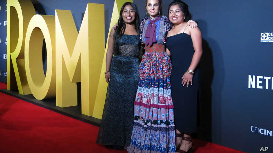 "FILE - Mexican actresses who star in the Mexican film ""Roma,"" Yalitza Aparicio, from left, Marina de Tavira and Nancy Garcia, pose on the red carpet in Mexico City, Nov. 21, 2018."