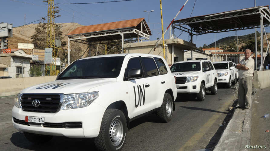 A convoy of vehicles carrying United Nations inspectors leaves the Masna'a border crossing between Lebanon and Syria, Sept. 30, 2013.