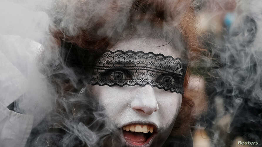 """A participant takes part in a """"Zombie Walk"""" parade in Kiev, Ukraine, Oct. 28, 2017."""