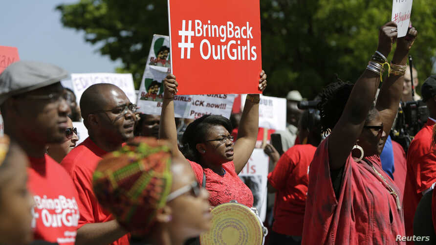 Protesters march in support of the girls kidnapped by members of Boko Haram in front of the Nigerian Embassy in Washington on May 6, 2014.