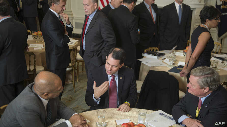 FILE - Wisconsin Governor Scott Walker (C) speaks during a meeting of the National Governors Association at the White House in Washington, DC, Feb. 23, 2015.