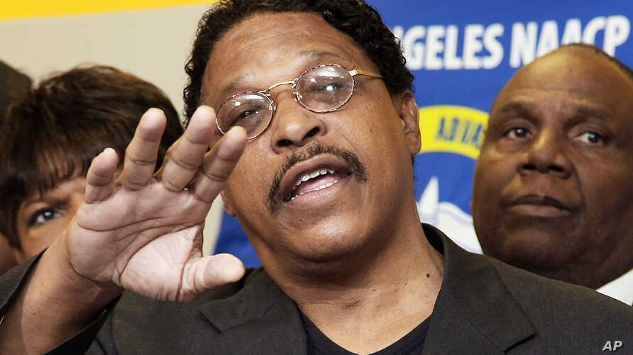 FILE - This April 28, 2014  photo shows Leon Jenkins, president of the Los Angeles chapter of the NAACP, announcing that Los Angeles Clippers basketball team owner Donald Sterling will not receive his lifetime achievement award, at a news conference