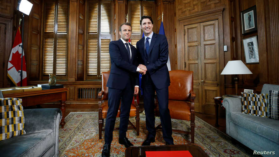 Canada's Prime Minister Justin Trudeau shakes hands with French President Emmanuel Macron during a meeting in Trudeau's office on Parliament Hill in Ottawa, Ontario, Canada, June 6, 2018.
