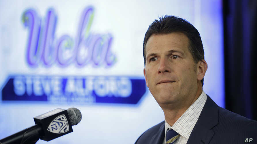 FILE - UCLA head men's basketball coach Steve Alford listens to questions during the Pac-12's NCAA college basketball media day, in San Francisco, Oct. 12, 2017.