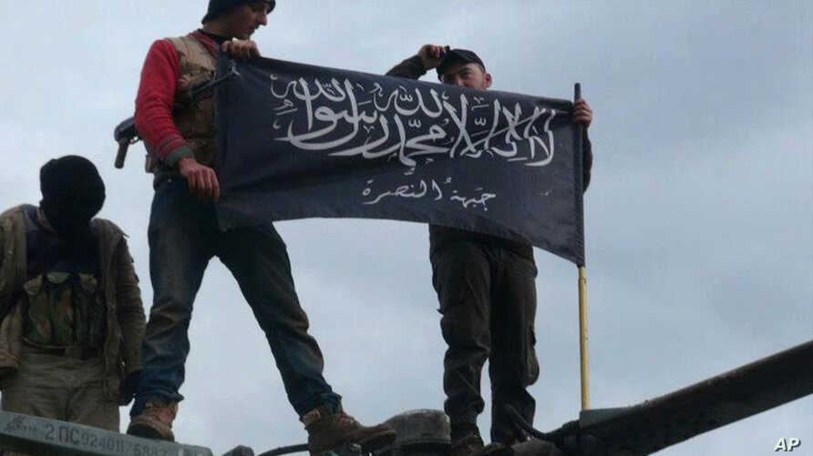 Rebels  from al-Qaida affiliated Jabhat al-Nusra waving their brigade flag