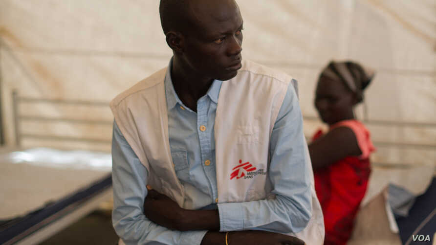 A  medic sits in the in-patient department of the MSF clinic set up at the camp for displaced people in the grounds of the United Nations Mission to South Sudan (UNMISS) base in Juba, South Sudan, on January 12, 2014.
