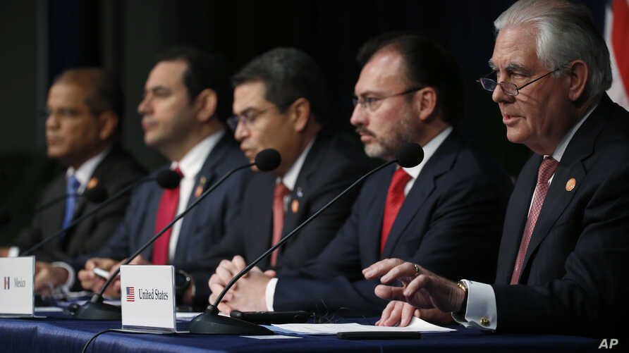 Secretary of State Rex Tillerson, right, gestures as he speaks during the Conference on Prosperity and Security in Central America, June 15, 2017, in Miami. Tillerson was joined by Mexican Foreign Secretary Luis Videgaray, second from left; Honduran
