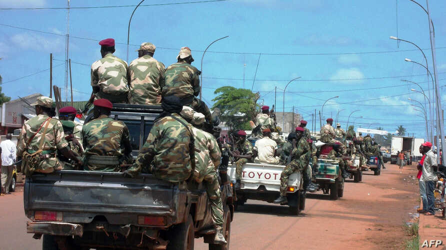 Central African troops in charge of disarmament drive a tank through Bangui, Central African Republic, Sept. 5, 2013.