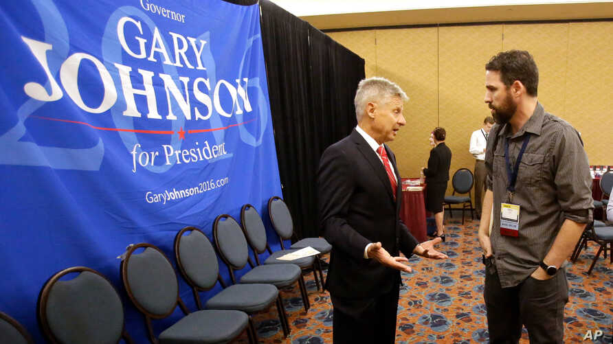 Libertarian presidential candidate Gary Johnson speaks to a delegate at the National Libertarian Party Convention, May 27, 2016, in Orlando, Fla.
